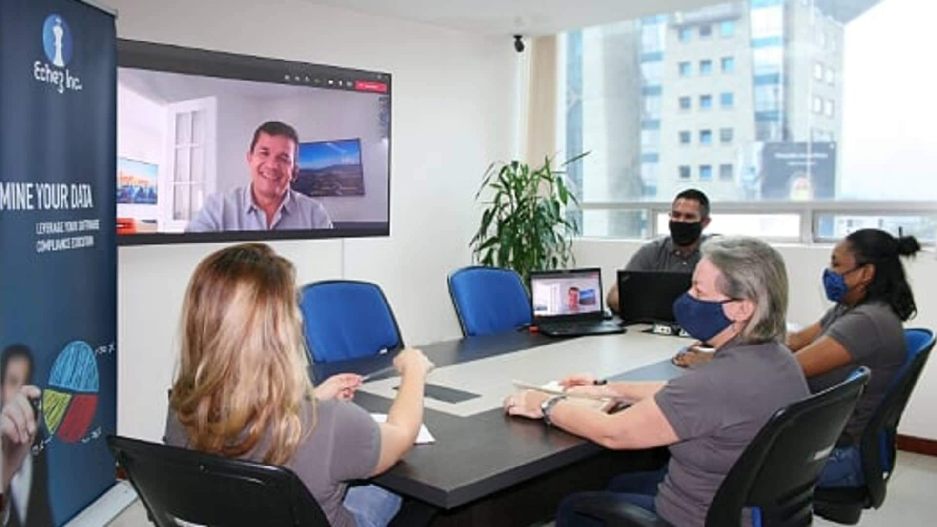 Edwin Sanchez, Echez Group CEO and member of the Latino Business Action Network meets with team members remotely.