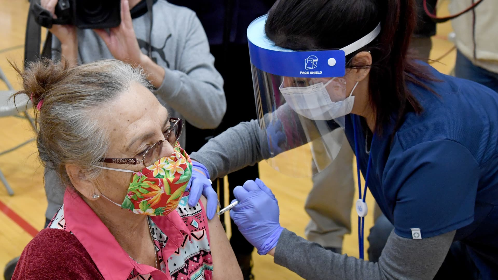 Flor Rodriguez (L), 72, of Nevada, receives a Pfizer-BioNTech COVID-19 vaccination from Southern Nevada Health District nurse Daliah Rubio at Jerome Mack Middle School on January 29, 2021 in Las Vegas, Nevada.