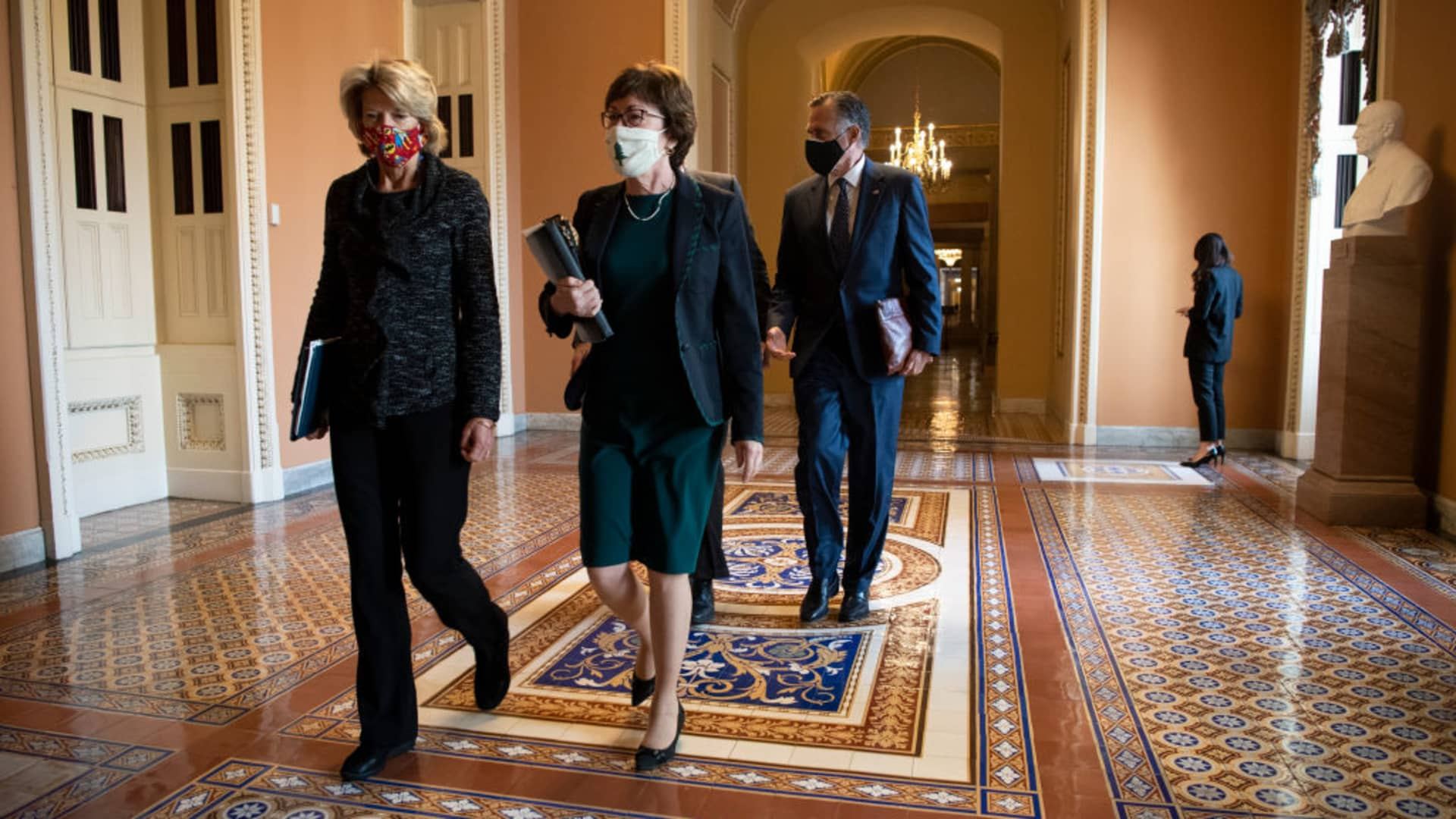Sen. Lisa Murkowski, R-Alaska, left, Sen. Susan Collins, R-Maine, Sen. Bill Cassidy, R-La., and Sen. Mitt Romney, R-Utah, depart from a meeting with Senate Majority Leader Mitch McConnell, R-Ky., in his office in Washington on Thursday, Dec. 3, 2020.