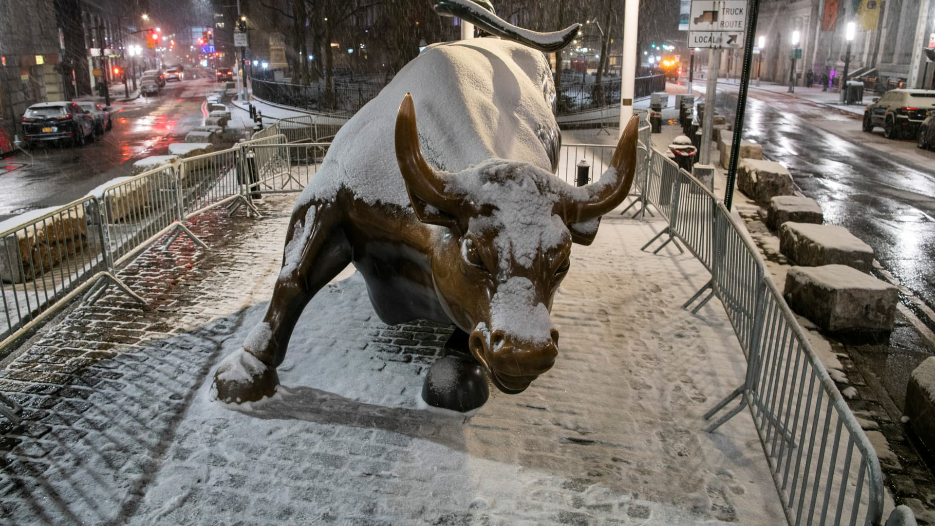 The bull of Wall Street is seen during the pass of the snowstorm on January 31, 2021 in New York City.