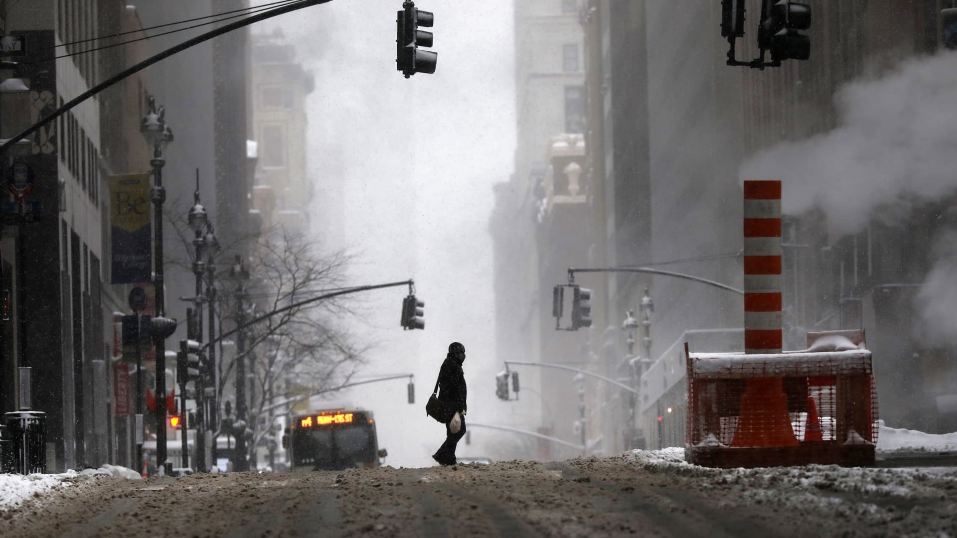 People walk through the snow in Manhattan on February 01, 2021 in New York City.