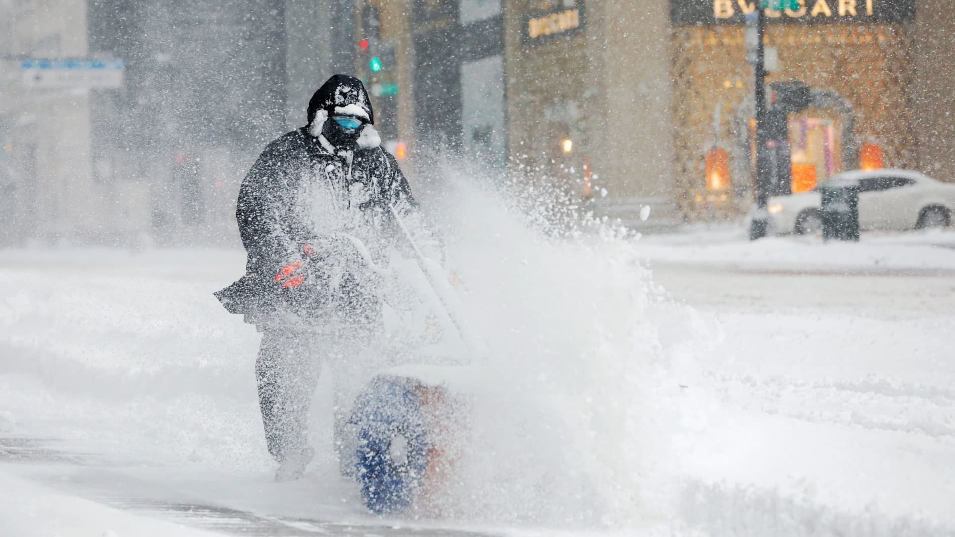 A worker clears a street during a snow storm, amid the coronavirus disease (COVID-19) outbreak, in New York, February 1, 2021.