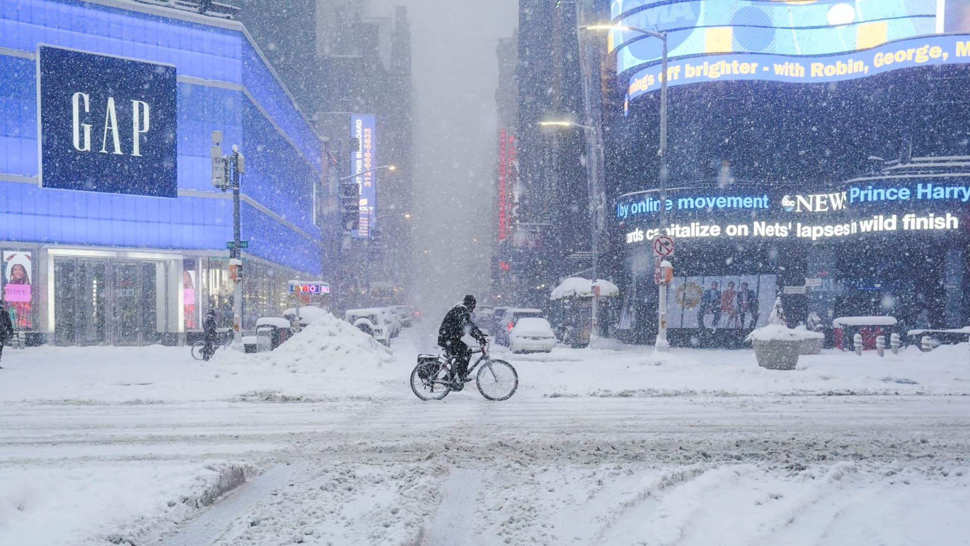 A person cycles through the Times Square during a snow storm, amid the coronavirus disease (COVID-19) pandemic, in New York, February 1, 2021.
