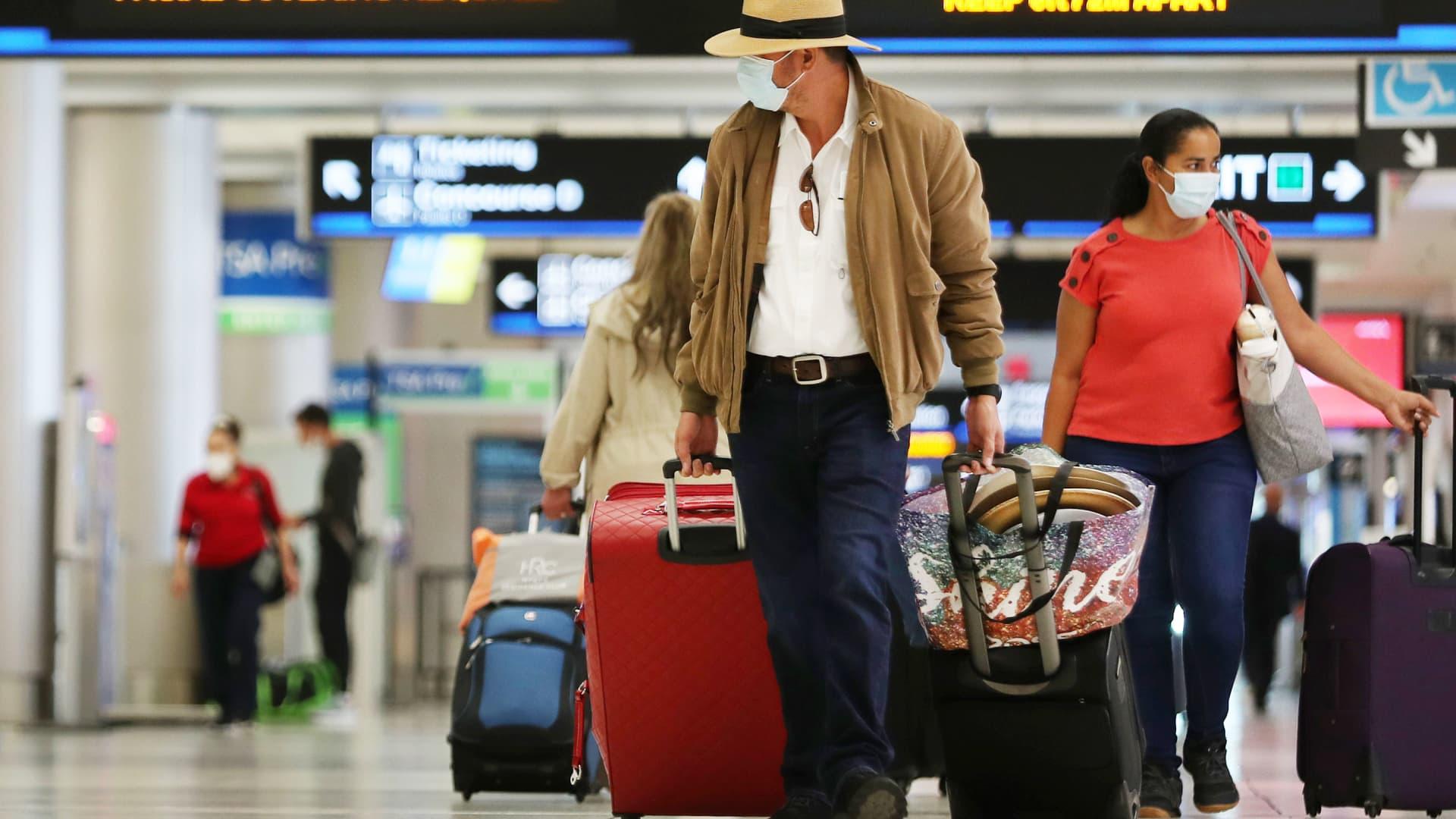 Travelers walk through Miami International Airport on February 01, 2021 in Miami, Florida.