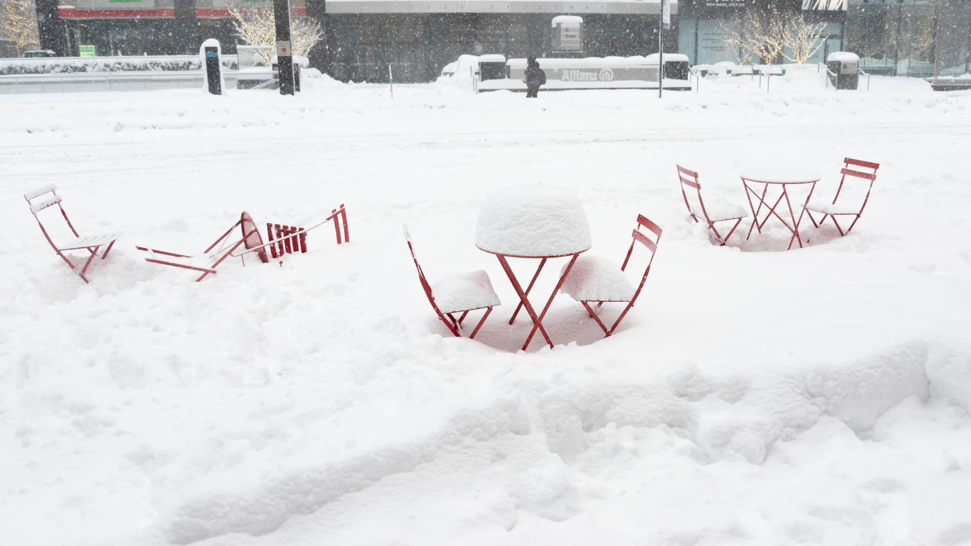 Dining tables are covered in snow outside a restaurant in Times Square during a snow storm on February 1, 2021 in New York City.
