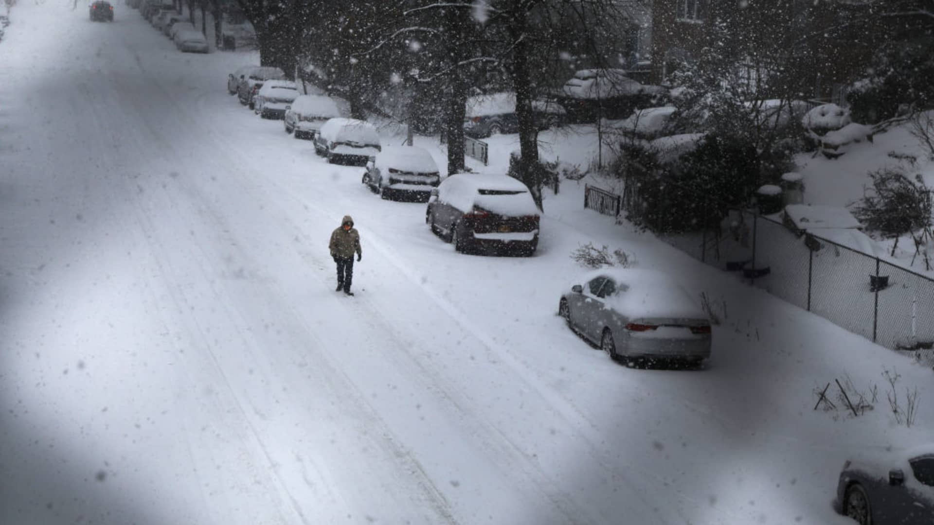 People walk through the snow in Brooklyn on February 01, 2021 in New York City.