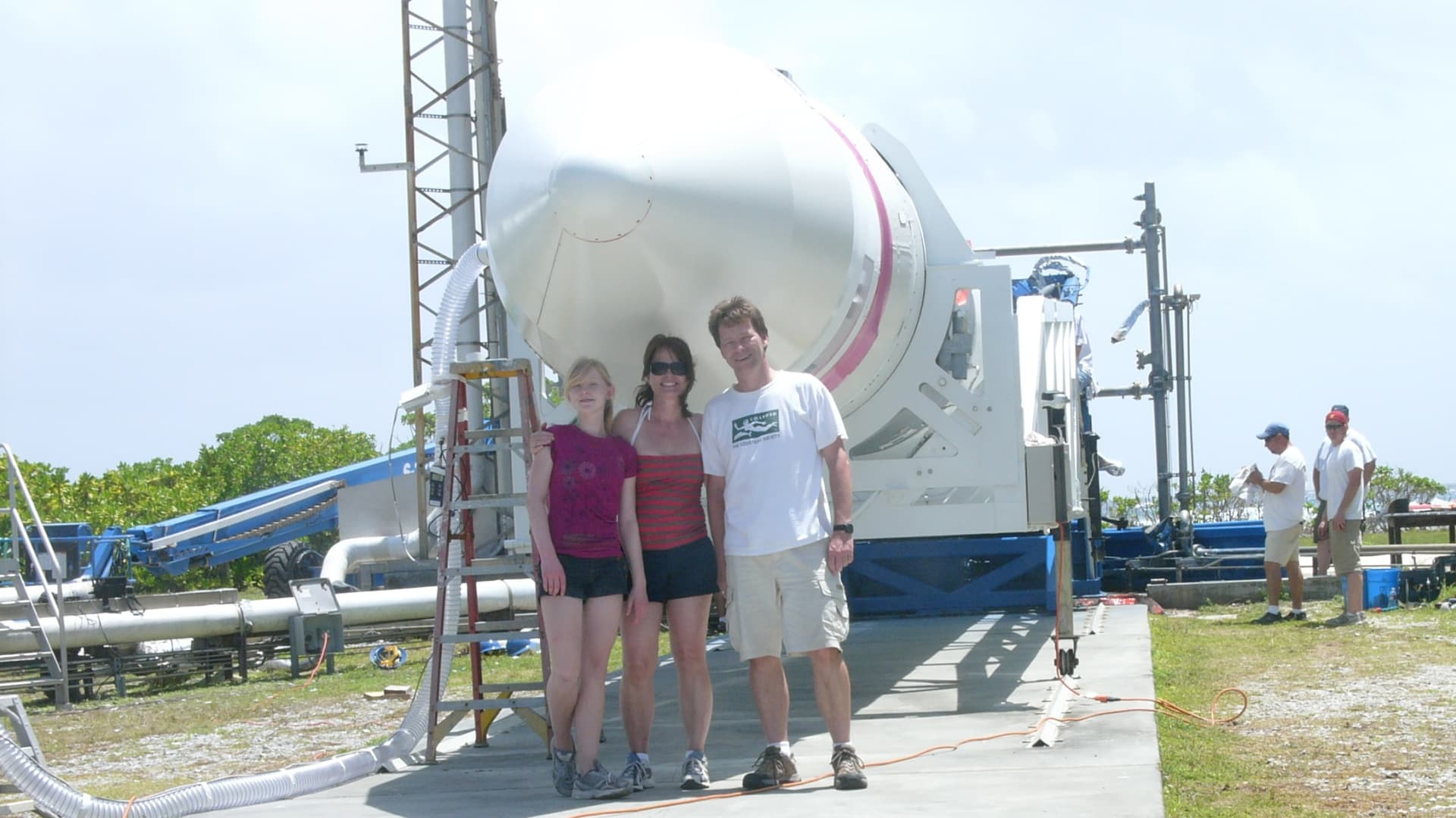 Hans Koenigsmann stands with his family in front of a Falcon 1 rocket at the company's launch facility on Omelek Island in the Kwajalein Atoll.