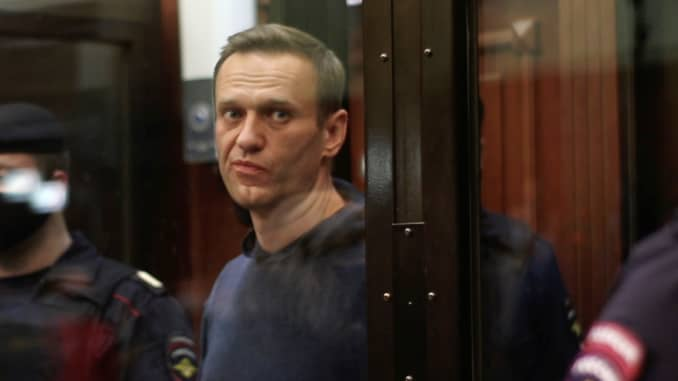 A still image taken from video footage shows Russian opposition leader Alexei Navalny, who is accused of flouting the terms of a suspended sentence for embezzlement, during the announcement of a court verdict in Moscow, Russia February 2, 2021.