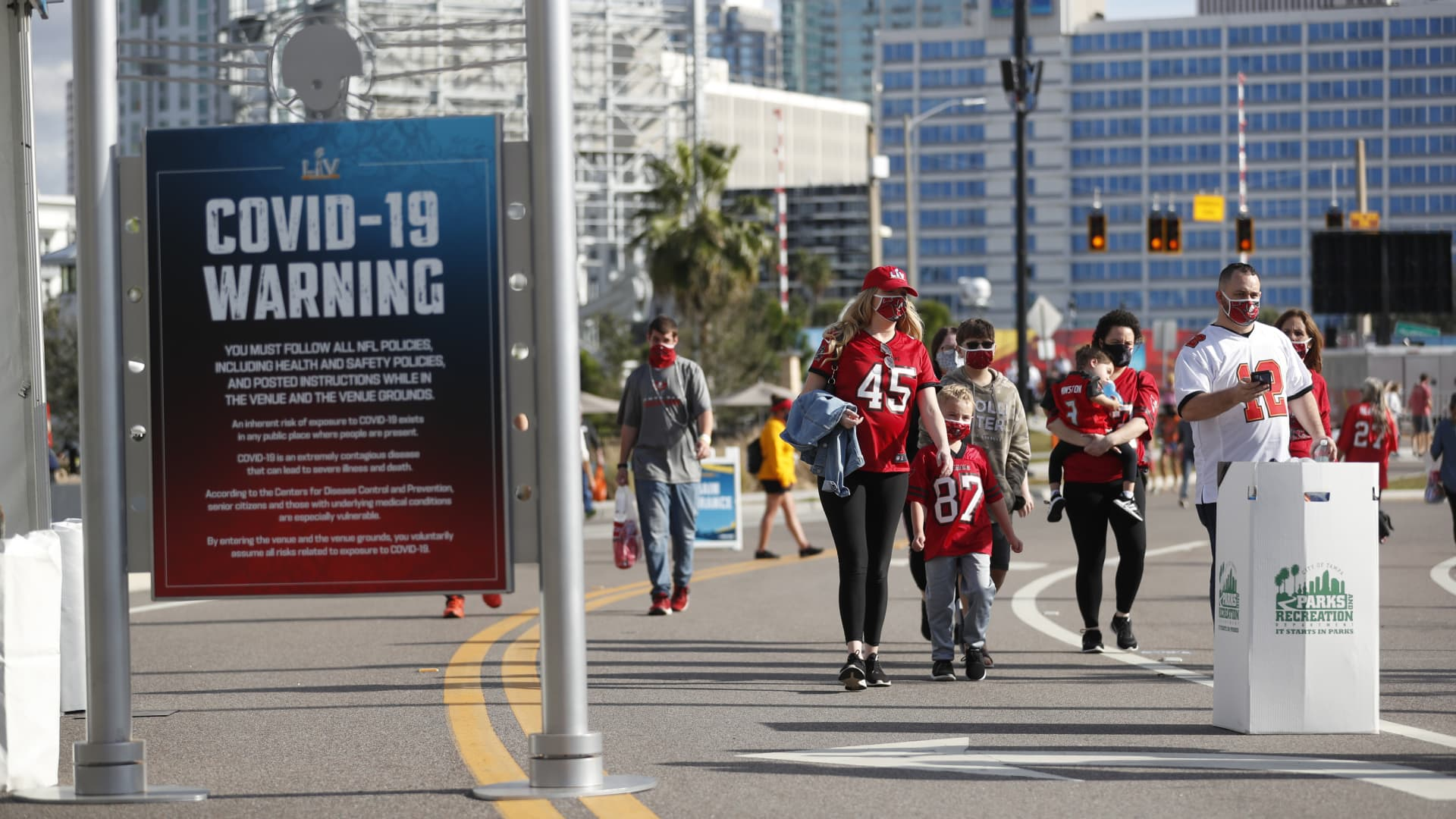 National Football League fans convene in downtown Tampa ahead of Super Bowl LV during the COVID-19 pandemic on January 30, 2021 in Tampa, Florida.