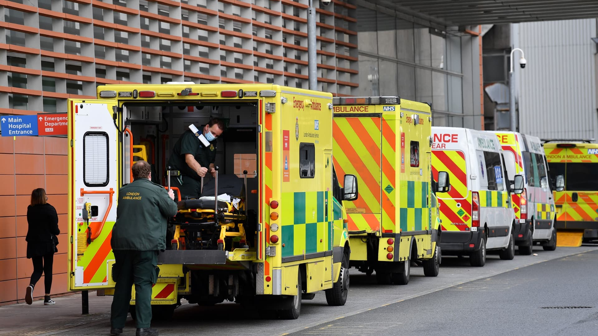 Paramedics move a patient from a ambulance to the Royal London Hospital in east London on January 28, 2021.