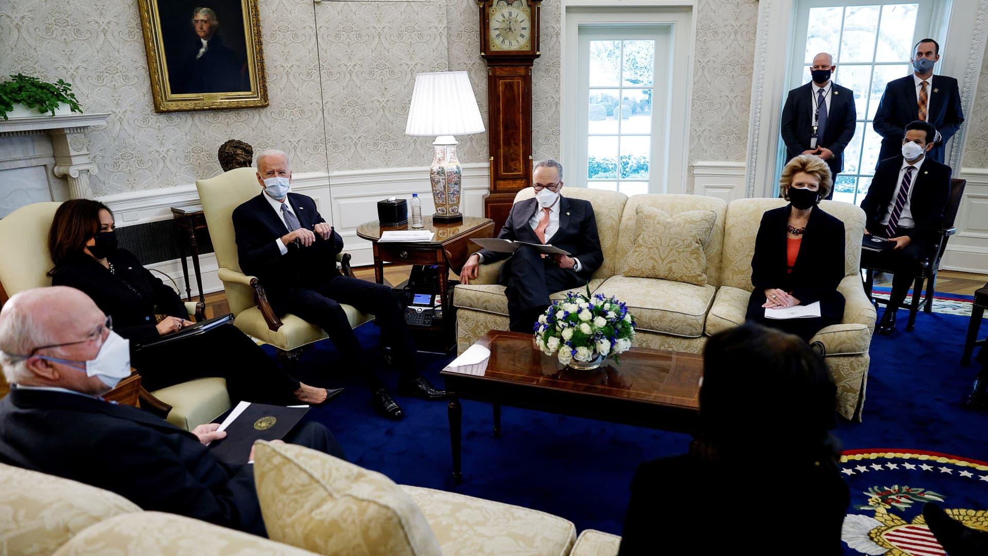 President Joe Biden and Vice President Kamala Harris discuss coronavirus aid legislation with Democratic senators during a meeting in the Oval Office at the White House in Washington, U.S., February 3, 2021.
