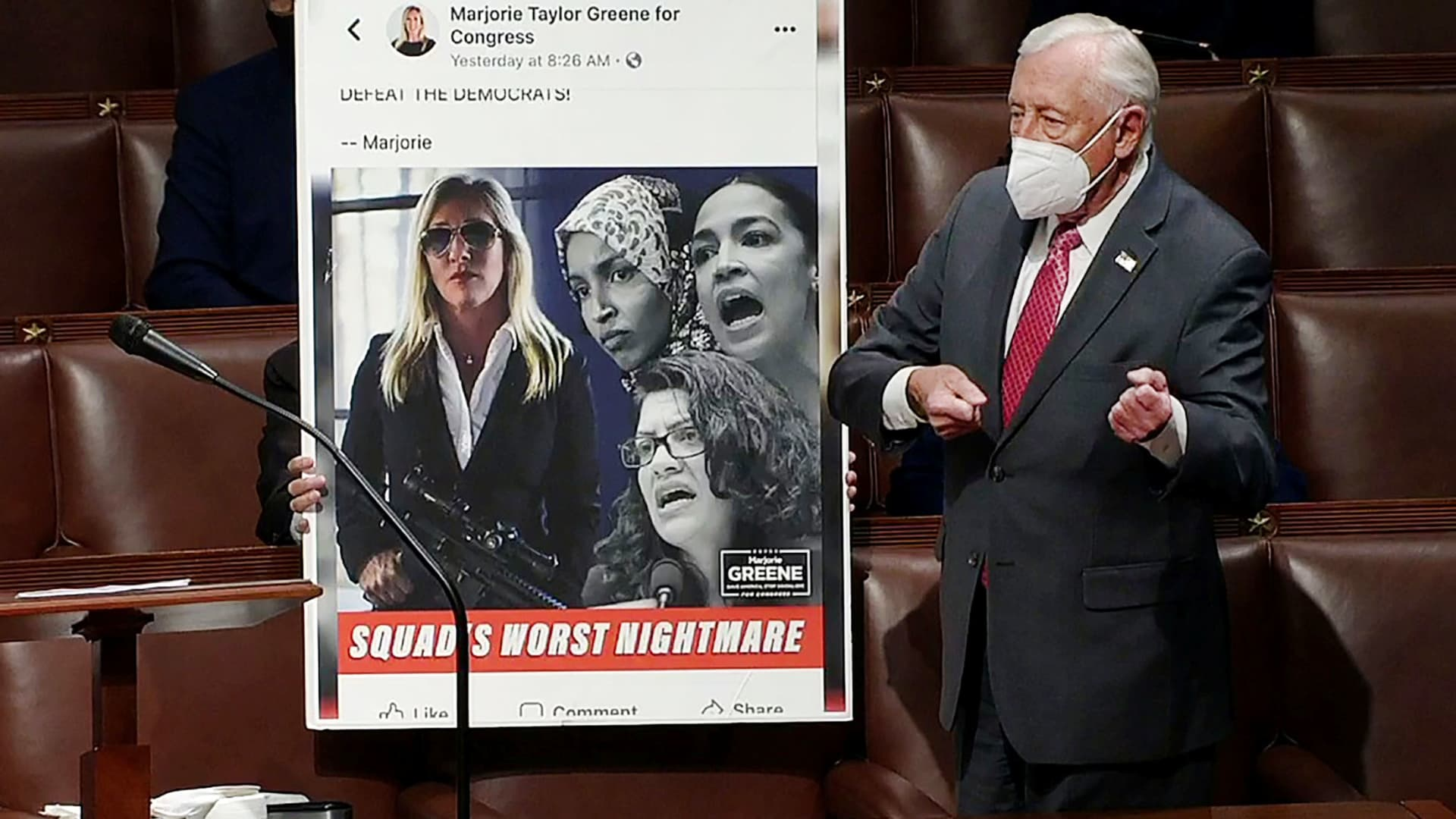 U.S. House Majority Leader Steny Hoyer (D-MD) mimics holding a gun next to an enlarged Tweet as he speaks during debate ahead of a House of Representatives vote on a Democratic-backed resolution that would punish Republican congresswoman Marjorie Taylor Greene, in this frame grab from video shot inside the House Chamber of the Capitol in Washington, February 4, 2021.