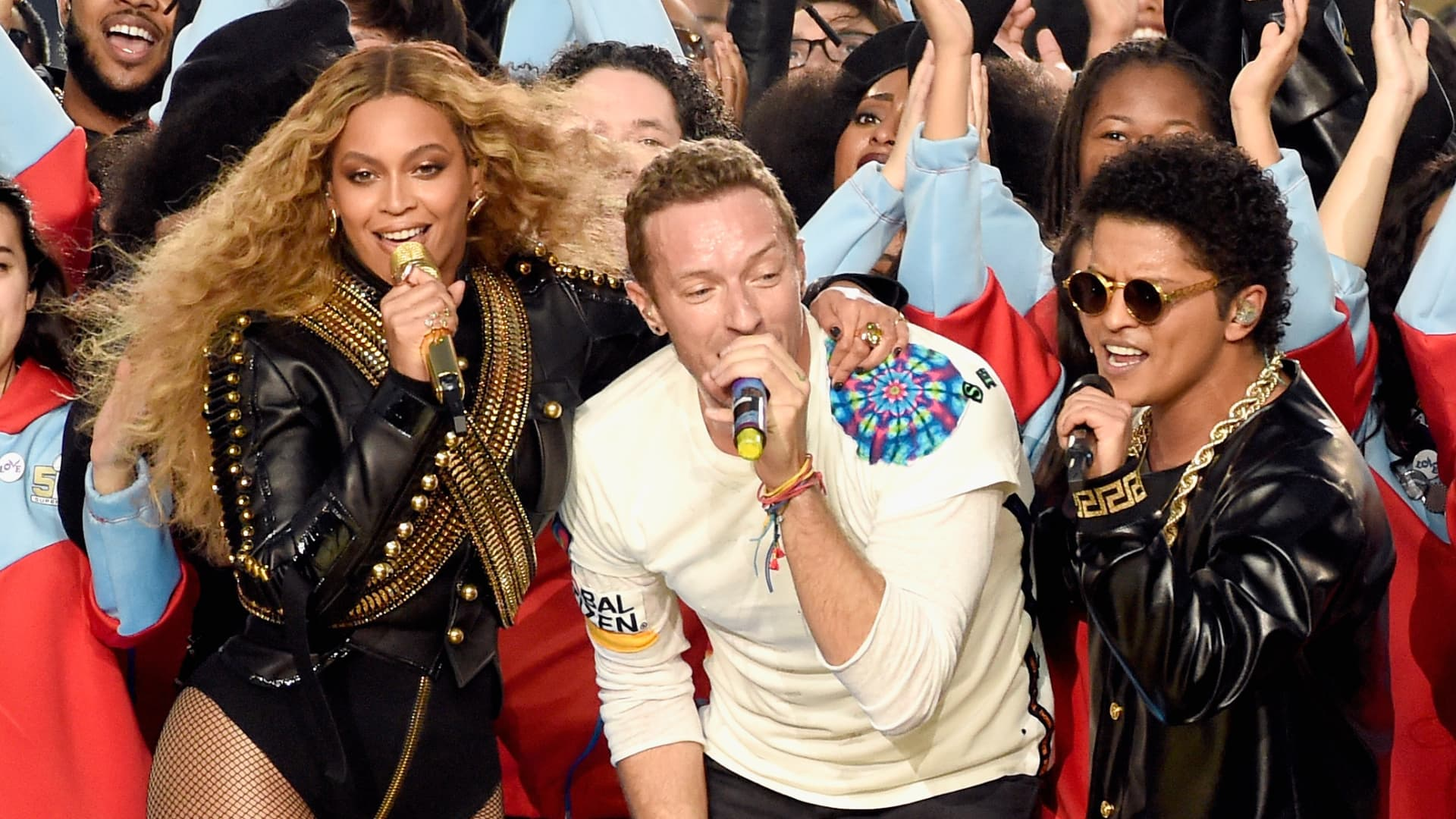 (L-R) Beyonce, Chris Martin of Coldplay and Bruno Mars perform onstage during the Pepsi Super Bowl 50 Halftime Show at Levi's Stadium on February 7, 2016 in Santa Clara, California.(Photo by Kevin Mazur/WireImage)