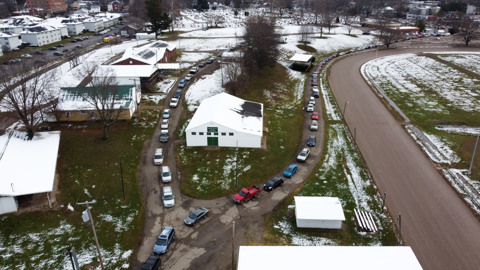 Cars line up to pick up food boxes at the Athens County Fairgrounds in Athens, Ohio on Dec. 19, 2020.
