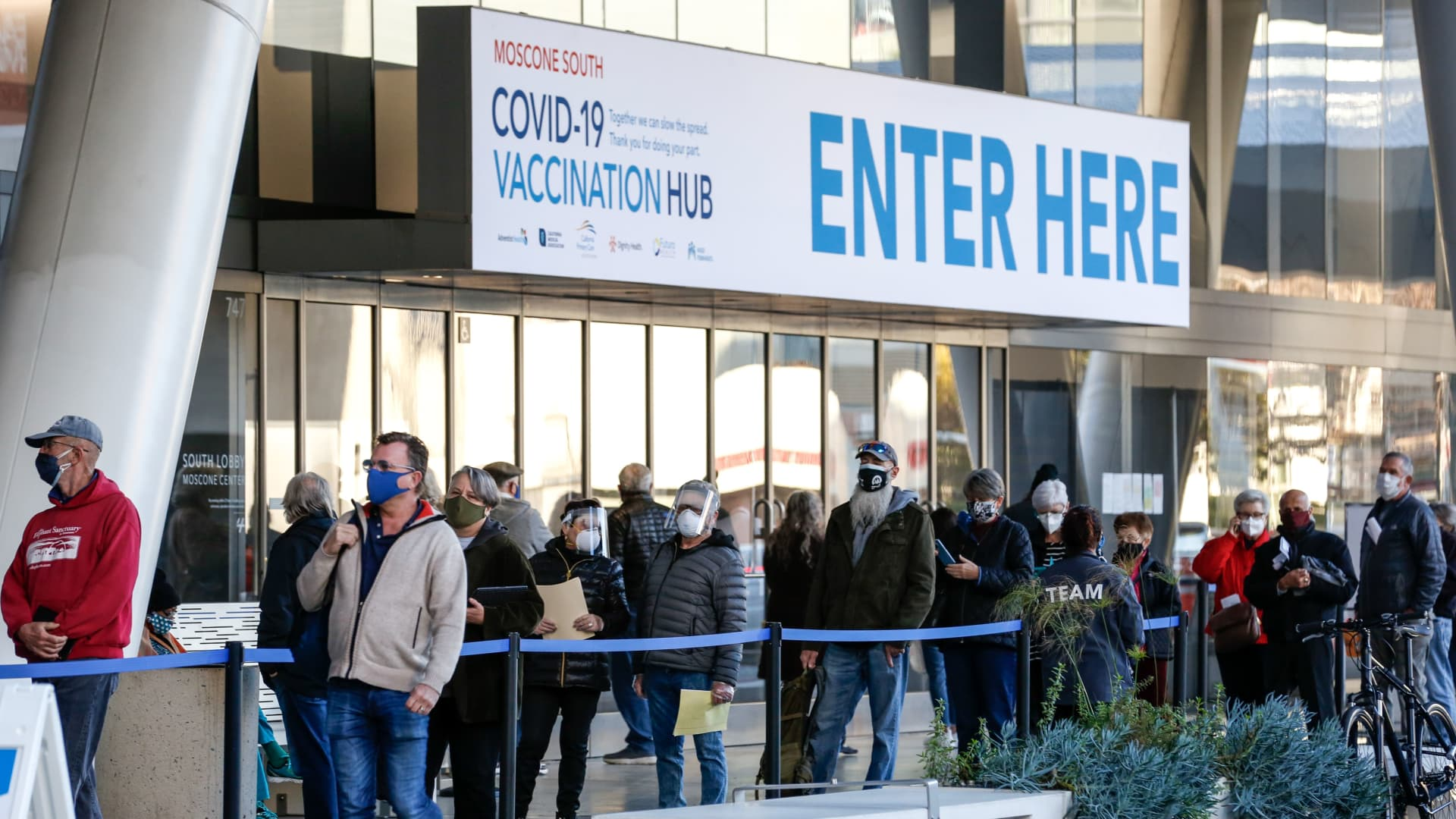 People stand in line at the mass vaccination site at San Francisco's Moscone Convention Center that opened today for healthcare workers and people over 65 on February 5, 2021 in San Francisco, California.