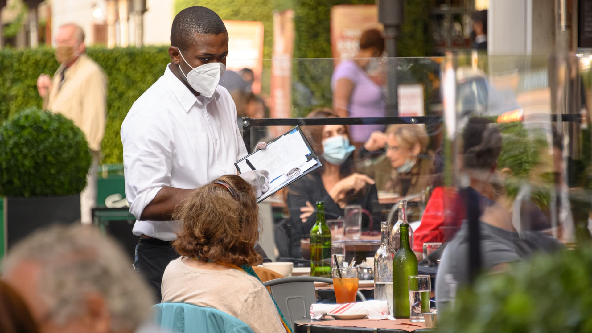 A waiter wears a face mask at a restaurant on the Upper West Side as the city continues the re-opening efforts following restrictions imposed to slow the spread of coronavirus on November 10, 2020 in New York City.