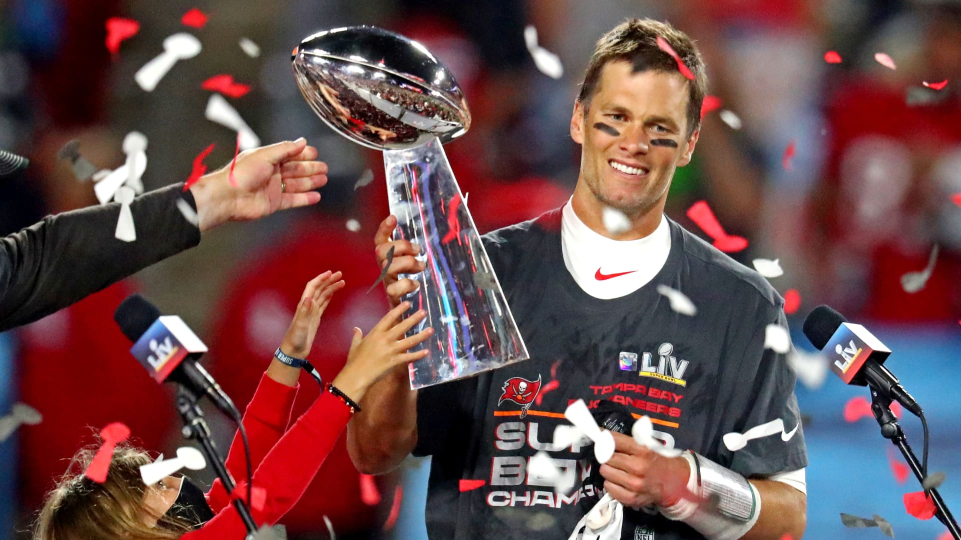 Tampa Bay Buccaneers quarterback Tom Brady (12) celebrates with the Vince Lombardi Trophy after beating the Kansas City Chiefs in Super Bowl LV at Raymond James Stadium.