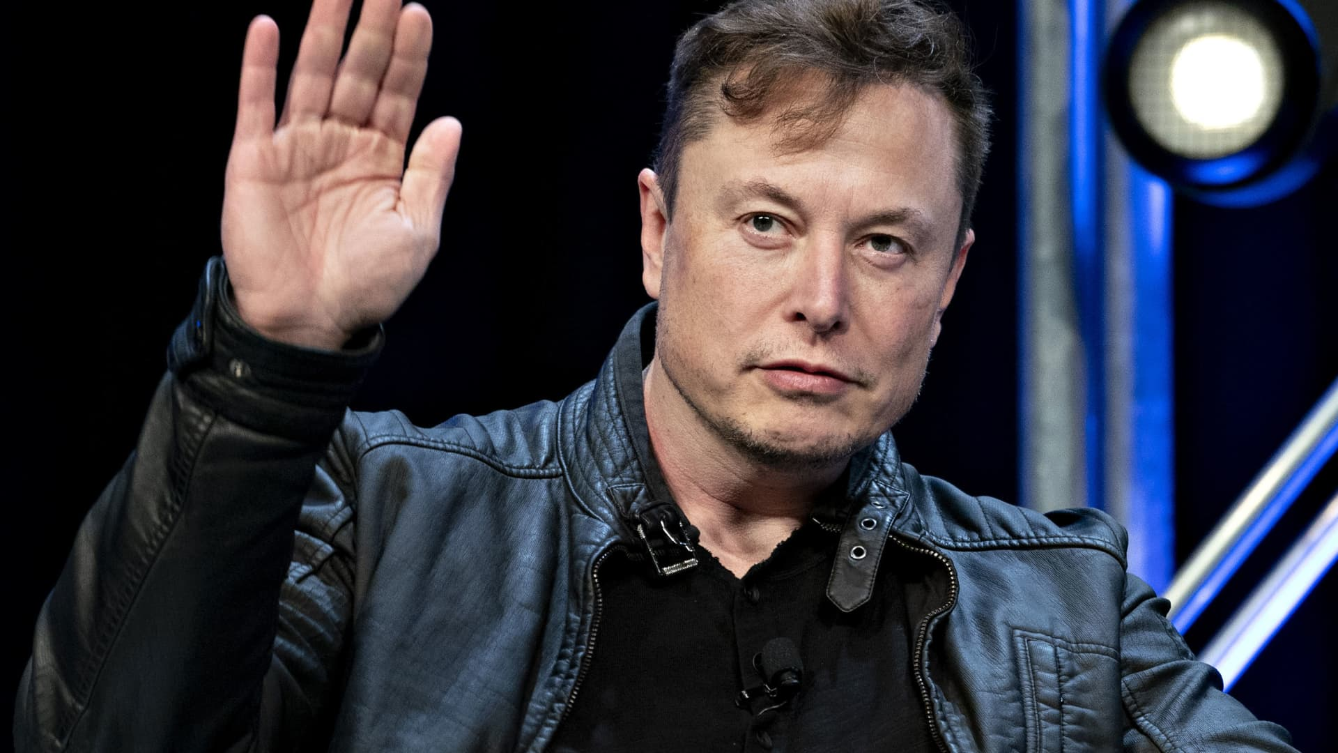 Elon Musk, founder of SpaceX and chief executive officer of Tesla, waves while arriving to a discussion at the Satellite 2020 Conference in Washington, D.C., on Monday, March 9, 2020.