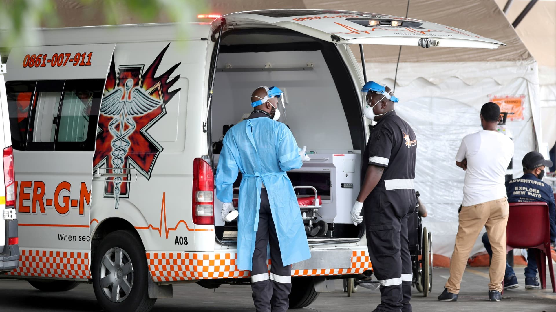 Health workers chat near an ambulance at the parking lot of the Steve Biko Academic Hospital, amid a nationwide coronavirus disease (COVID-19) lockdown, in Pretoria, South Africa, January 11, 2021.