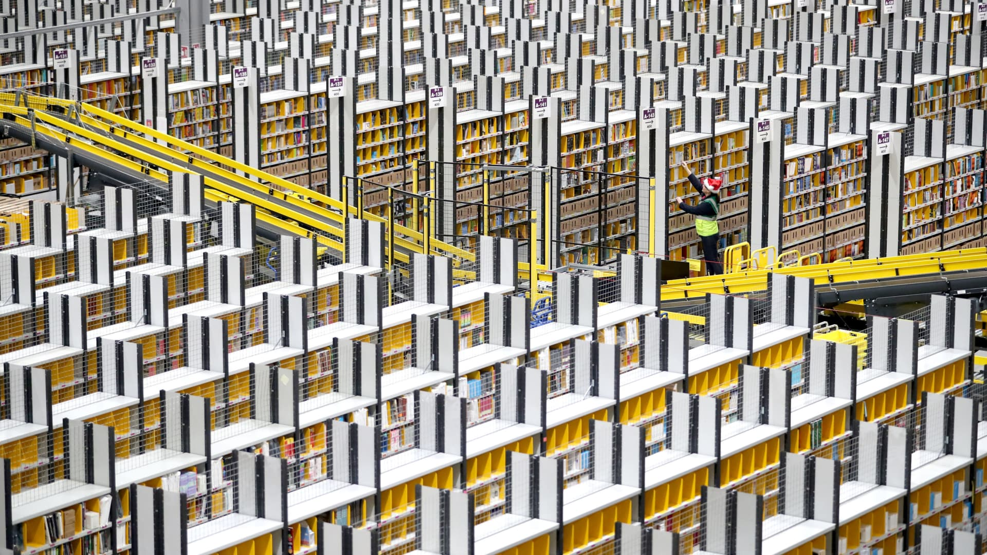 Staff make their way around the aisles collecting items before sending them to the on-site dispatch hall to be packaged inside one of Britain's largest Amazon warehouses in Dunfermline, Fife.