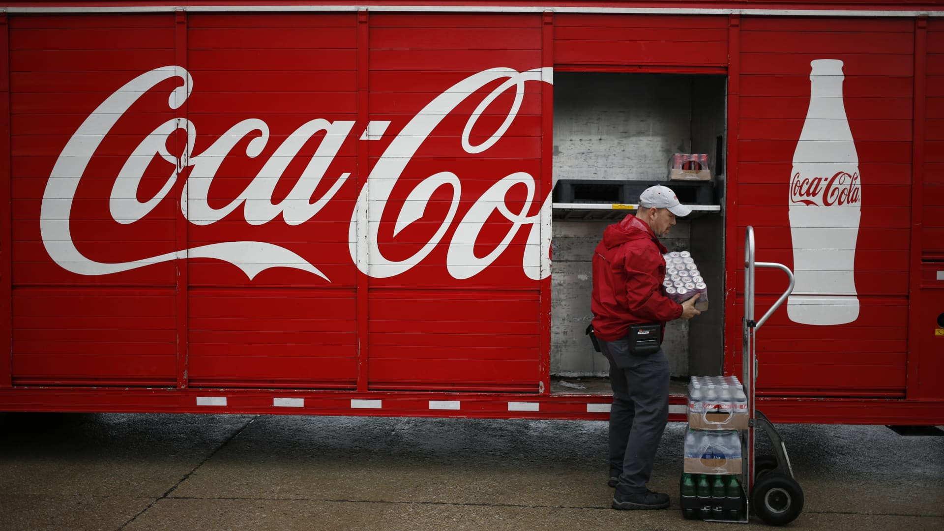 A delivery truck driver unloads Coca-Cola Co. soft drinks in Lawrenceburg, Kentucky, U.S., on Monday, Feb. 10, 2020.