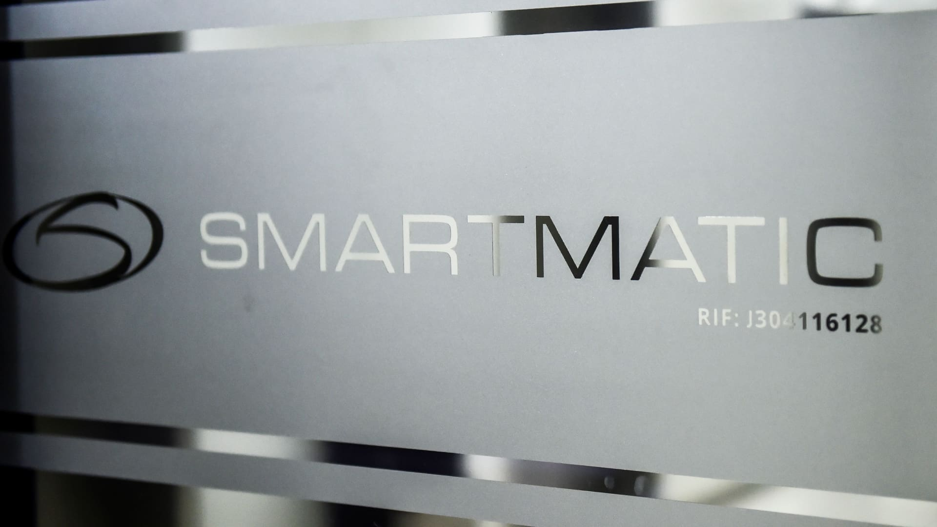 Picture of the logo of Smartmatic, the firm that supplies Venezuela's voting technology, seen on a sliding door at the headquarters of the company in Caracas.