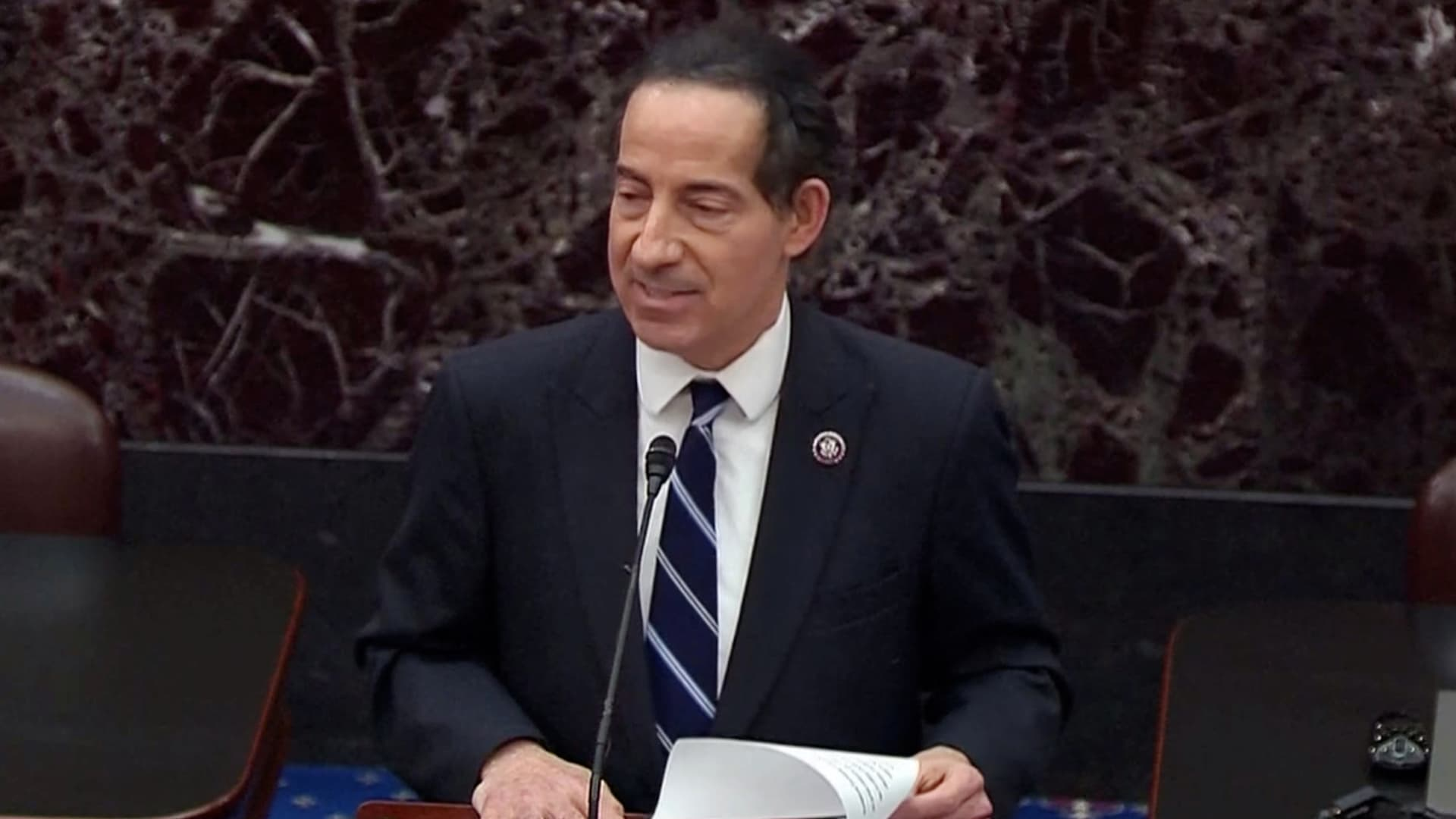 House lead impeachment manager Jamie Raskin (D-MD) reads the House article of impeachment against former President Donald Trump on accusations of inciting the January 6 attack on the Capitol, on the floor of the U.S. Senate in this frame grab from video shot at the U.S. Capitol in Washington, U.S., January 25, 2021.