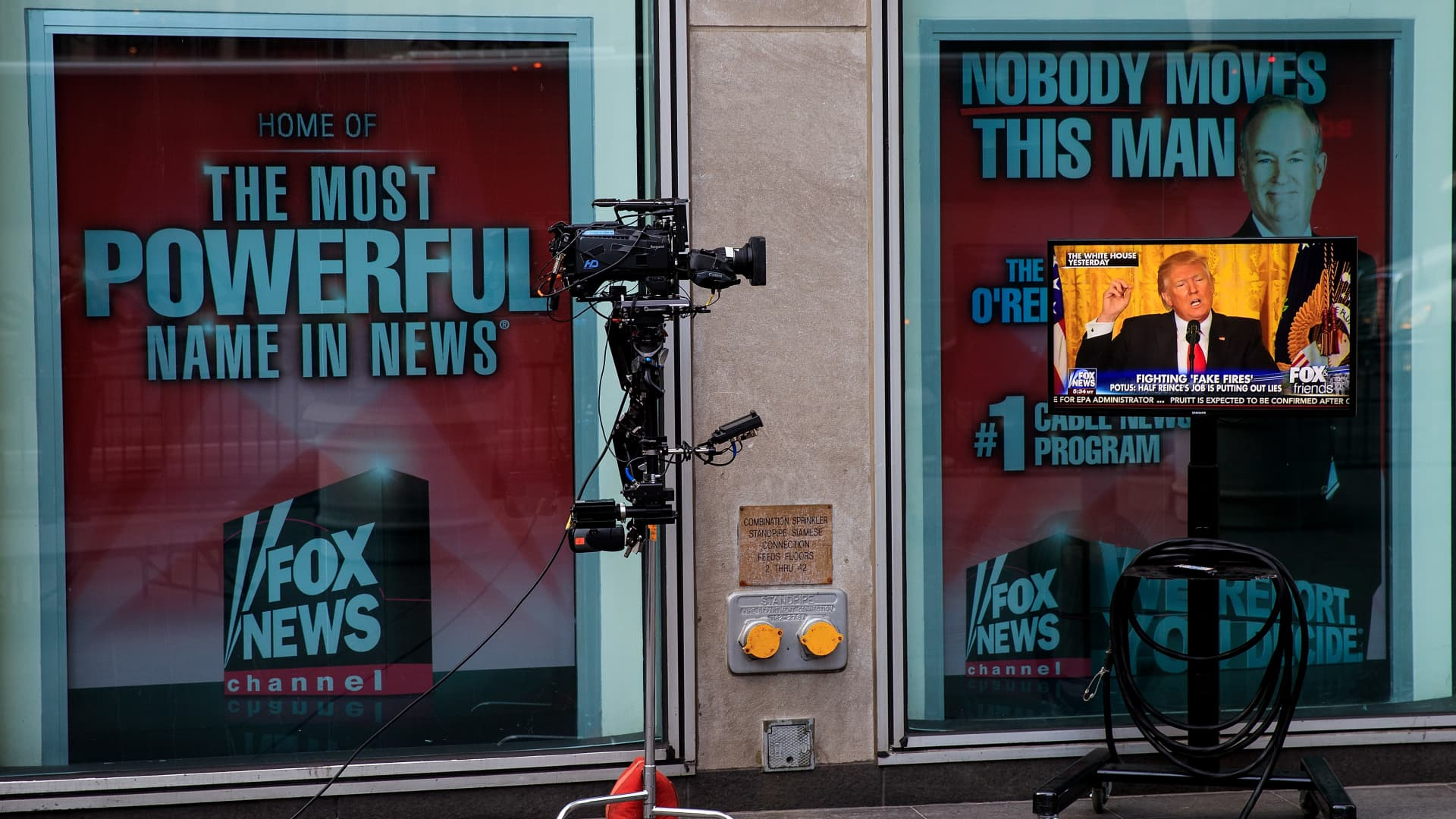 A clip of President Donald Trump's Thursday press conference is played on 'Fox And Friends', seen on a monitor outside of the Fox News studios, on February 17, 2017 in New York City.