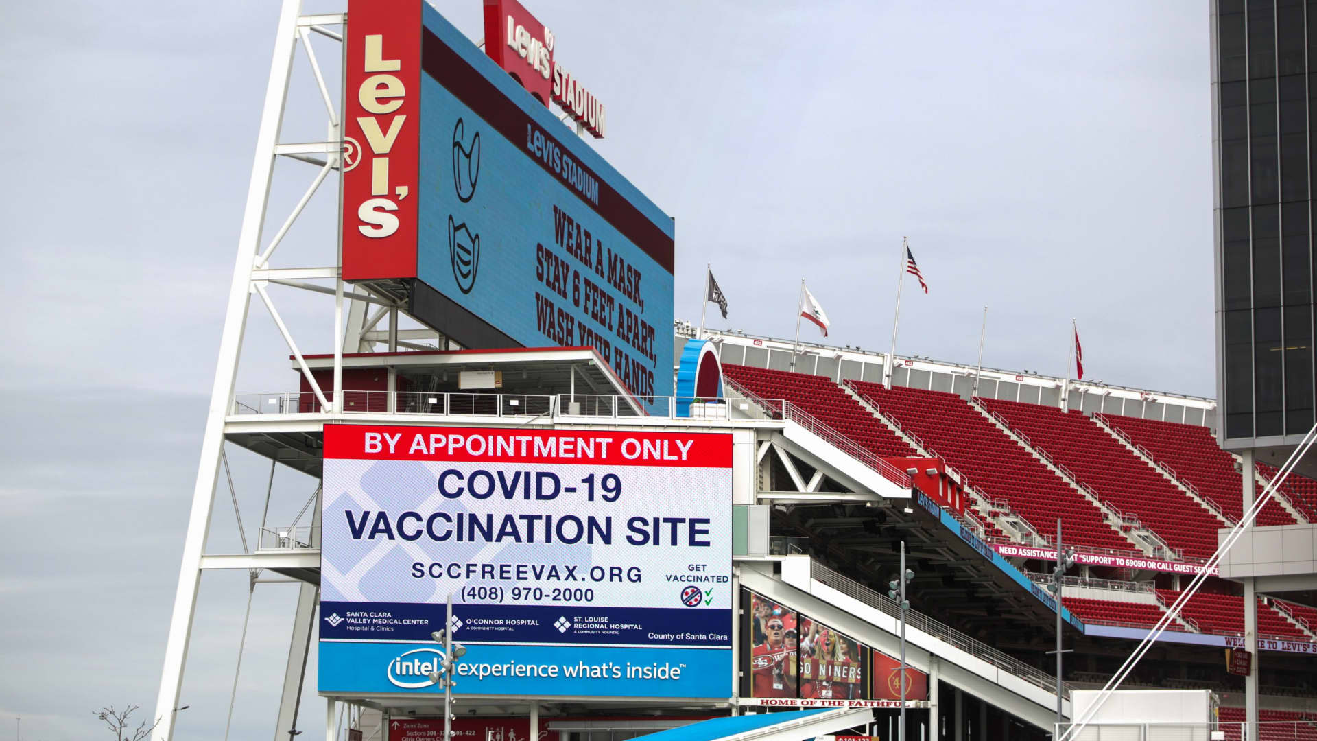 Signs show information for a vaccination site run by the Santa Clara County health department at Levi's Stadium, home of the San Francisco 49ers NFL football team, in Santa Clara, California, February 9, 2021.