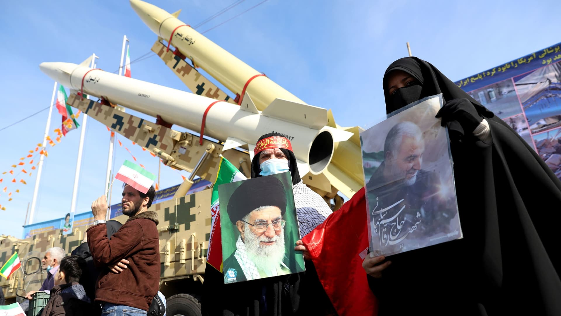 Iranian women hold pictures of the Supreme Leader Ayatollah Ali Khamenei and the late Iranian Major-General Qassem Soleimani, during the celebration of the 42nd anniversary of the Islamic Revolution in Tehran, Iran February 10, 2021.