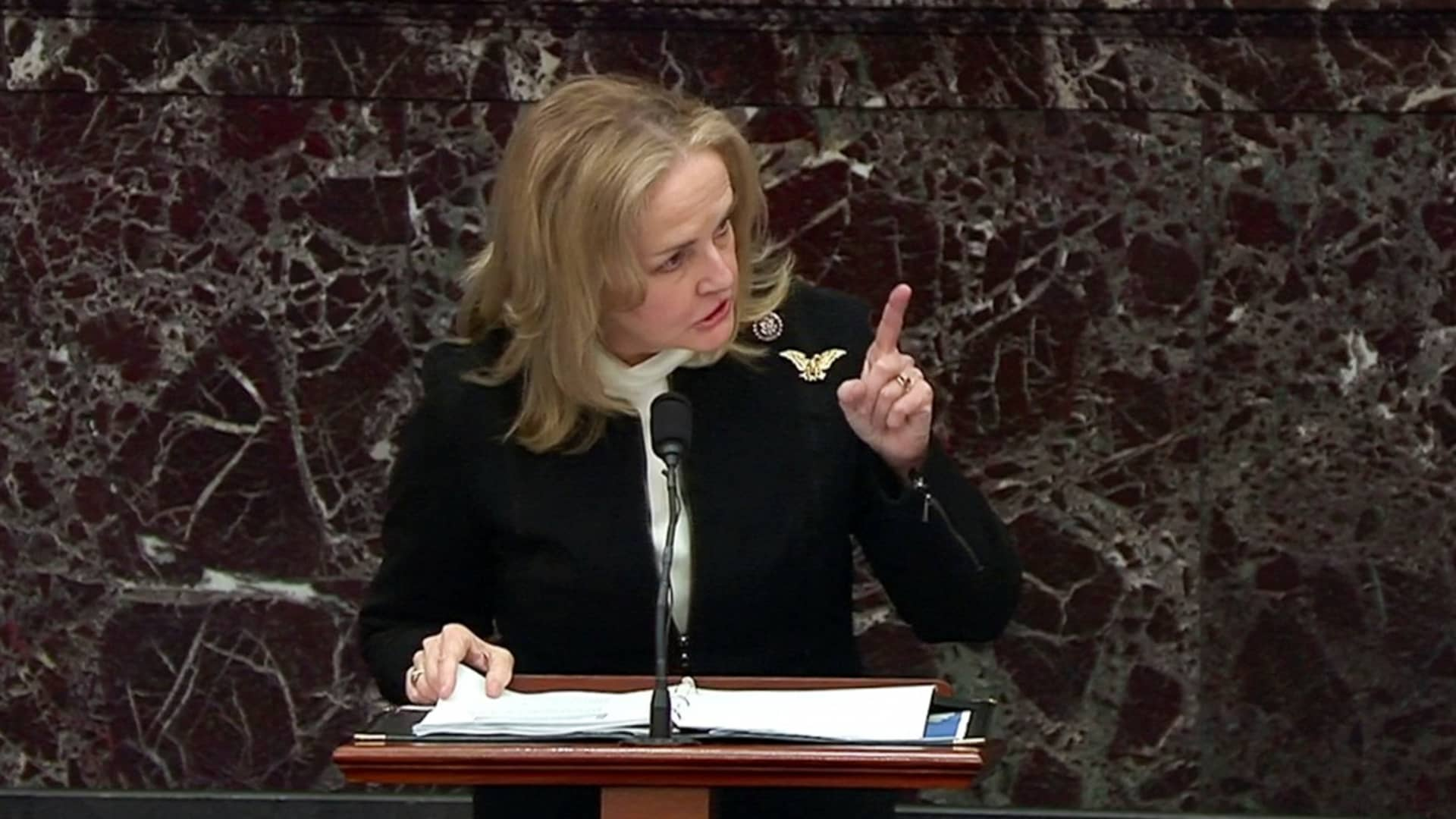 House impeachment manager Rep. Madeleine Dean (D-PA) delivers part of the impeachment managers' opening argument in the impeachment trial of former President Donald Trump, on charges of inciting the deadly attack on the U.S. Capitol, on the floor of the Senate chamber on Capitol Hill in Washington, U.S., February 10, 2021.