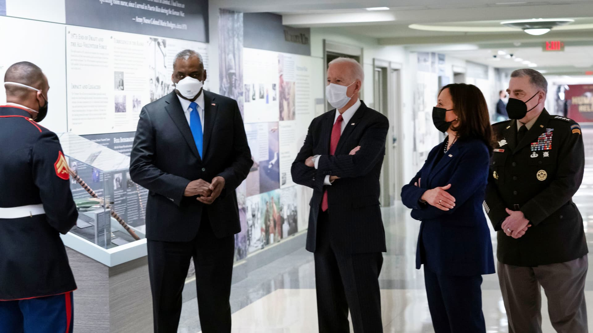 U.S. President Joe Biden, accompanied by Vice President Kamala Harris, Secretary of Defense Lloyd Austin, and Joint Chiefs of Staff Chairman Gen. Mark Milley, tours the African Americans in Defense of our Nations Corridor at the Pentagon in Arlington, Virginia, February 10, 2021.