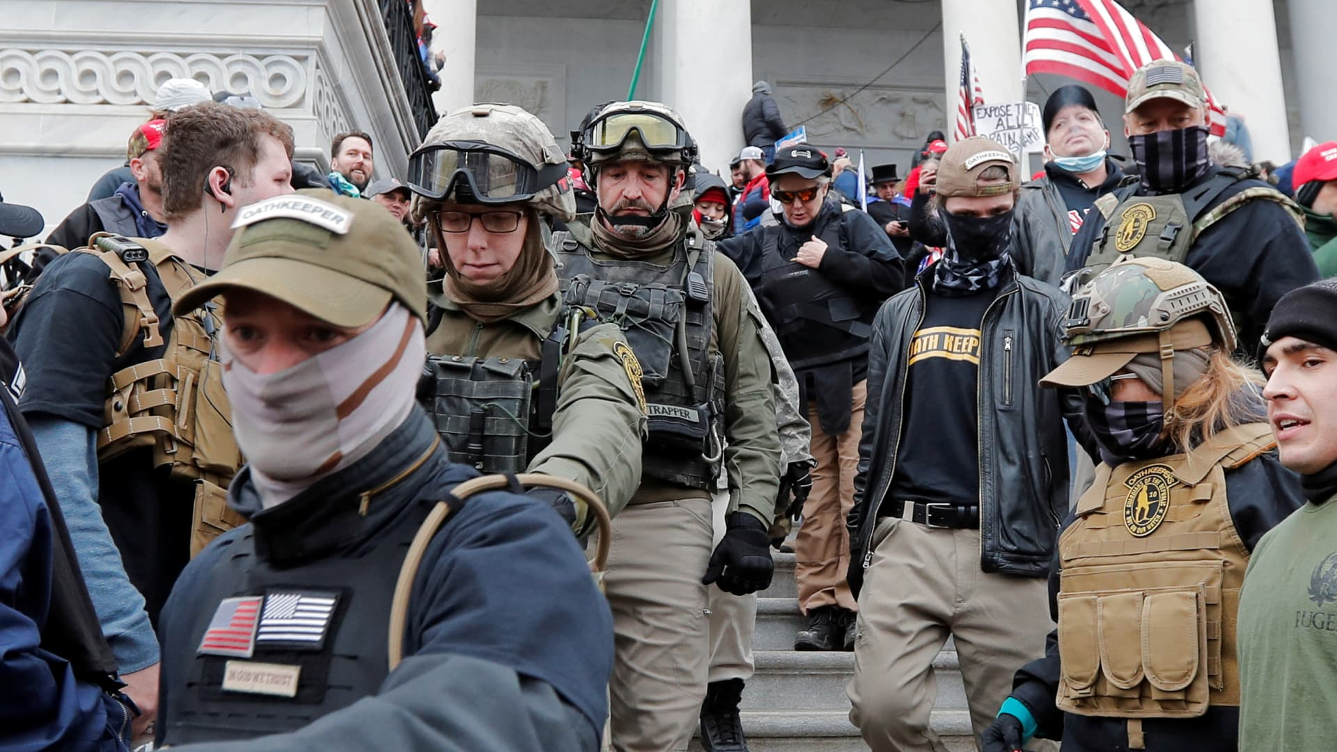 Jessica Marie Watkins (2nd from L) and Donovan Ray Crowl (Center), both from Ohio, march down the east front steps of the U.S. Capitol with the Oath Keepers militia group among supporters of U.S. President Donald Trump in Washington, January 6, 2021. Both have since been indicted by federal authorities for their roles in the siege on the U.S. Capitol.