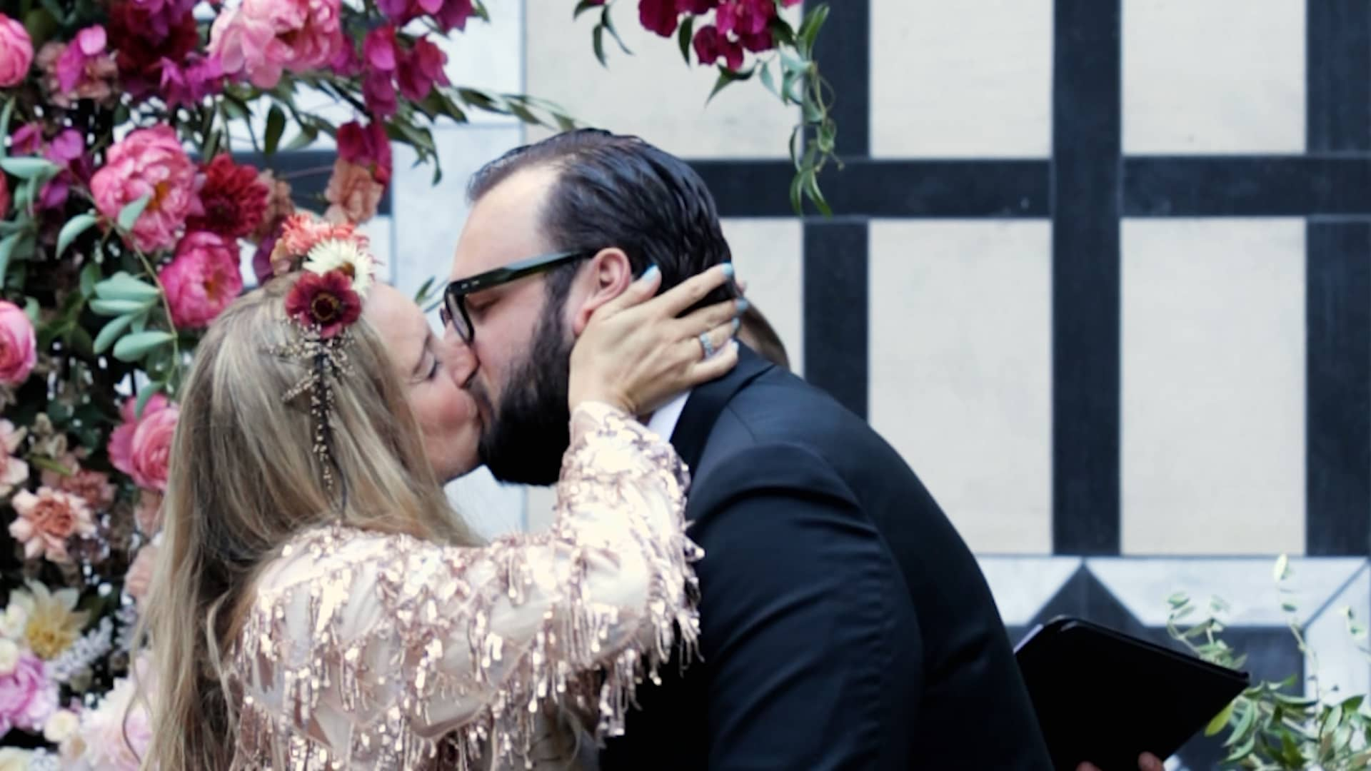 Kayla and Andrew share a kiss during their wedding ceremony.