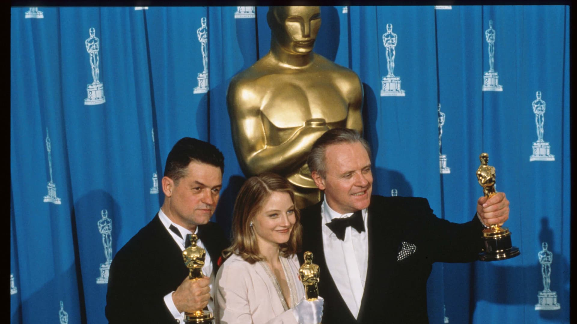 Best Actor recipient Anthony Hopkins, Best Actress recipient Jodie Foster and Best Director recipient Jonathan Demme hold their Oscars at the 64th annual Academy Awards March 30, 1992 in Los Angeles, CA.