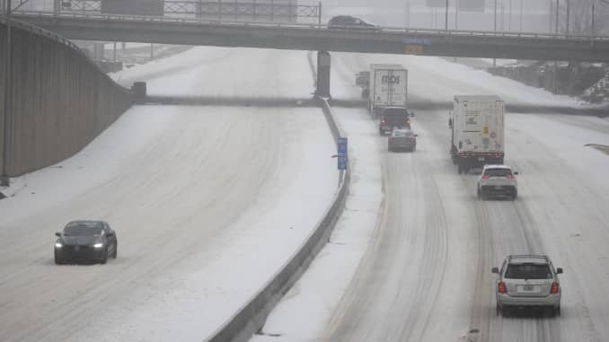 Vehicles slowly drive on I-40 due to snow and ice on February 15, 2021 in Nashville, Tennessee.
