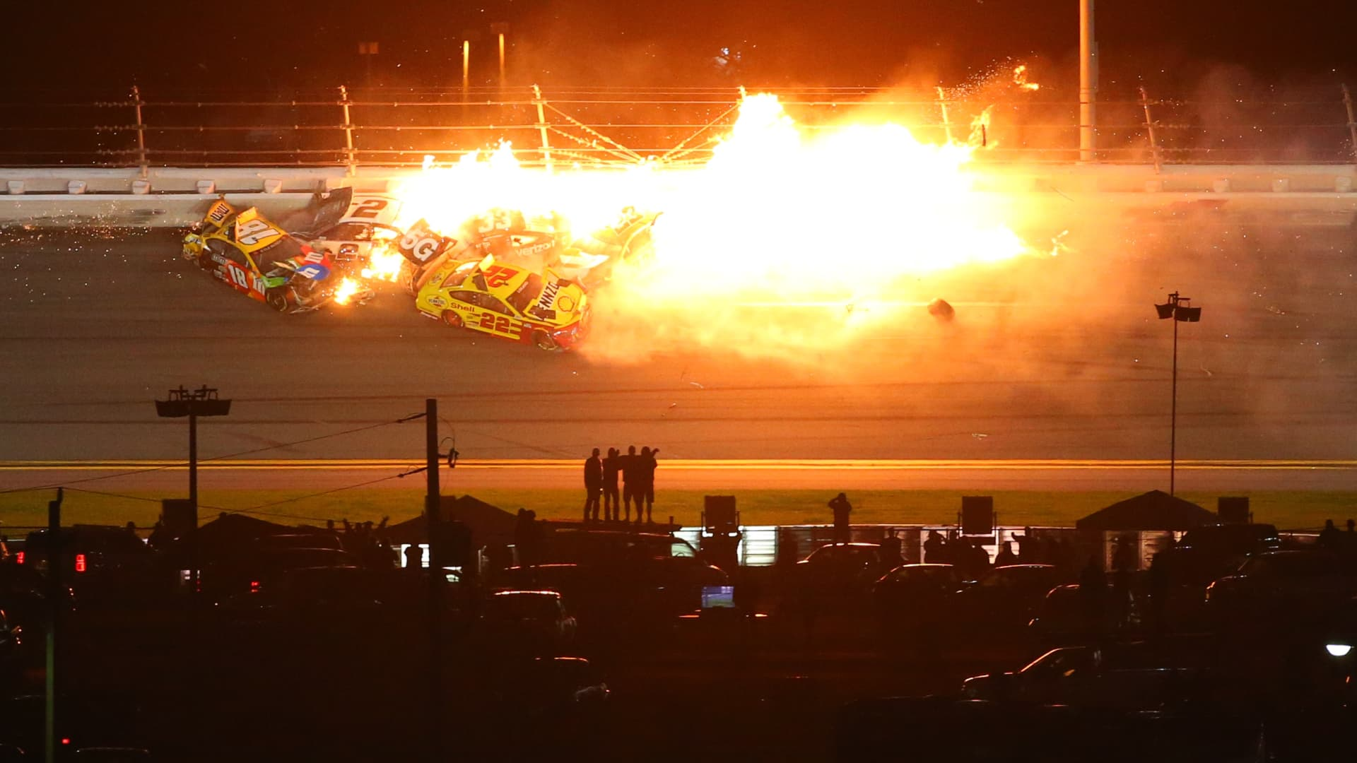 Flames erupt during a last-lap crash consumes several cars during the Daytona 500 on February 14, 2021 at Daytona International Speedway in Daytona Beach. Fl.