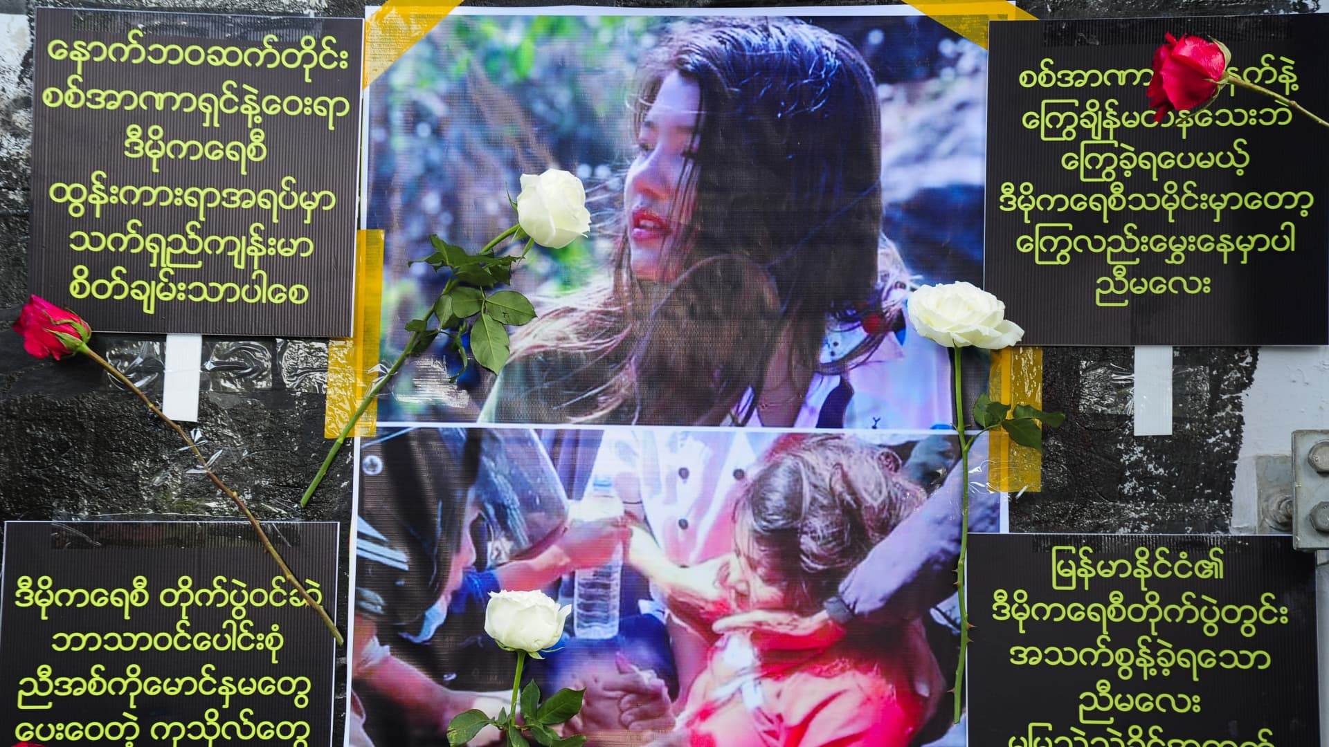Picture of Mya Thwe Thwe Khaing is displayed by anti-coup protesters near Myaynigone junction Saturday, February 20, 2021, in Yangon, Myanmar.