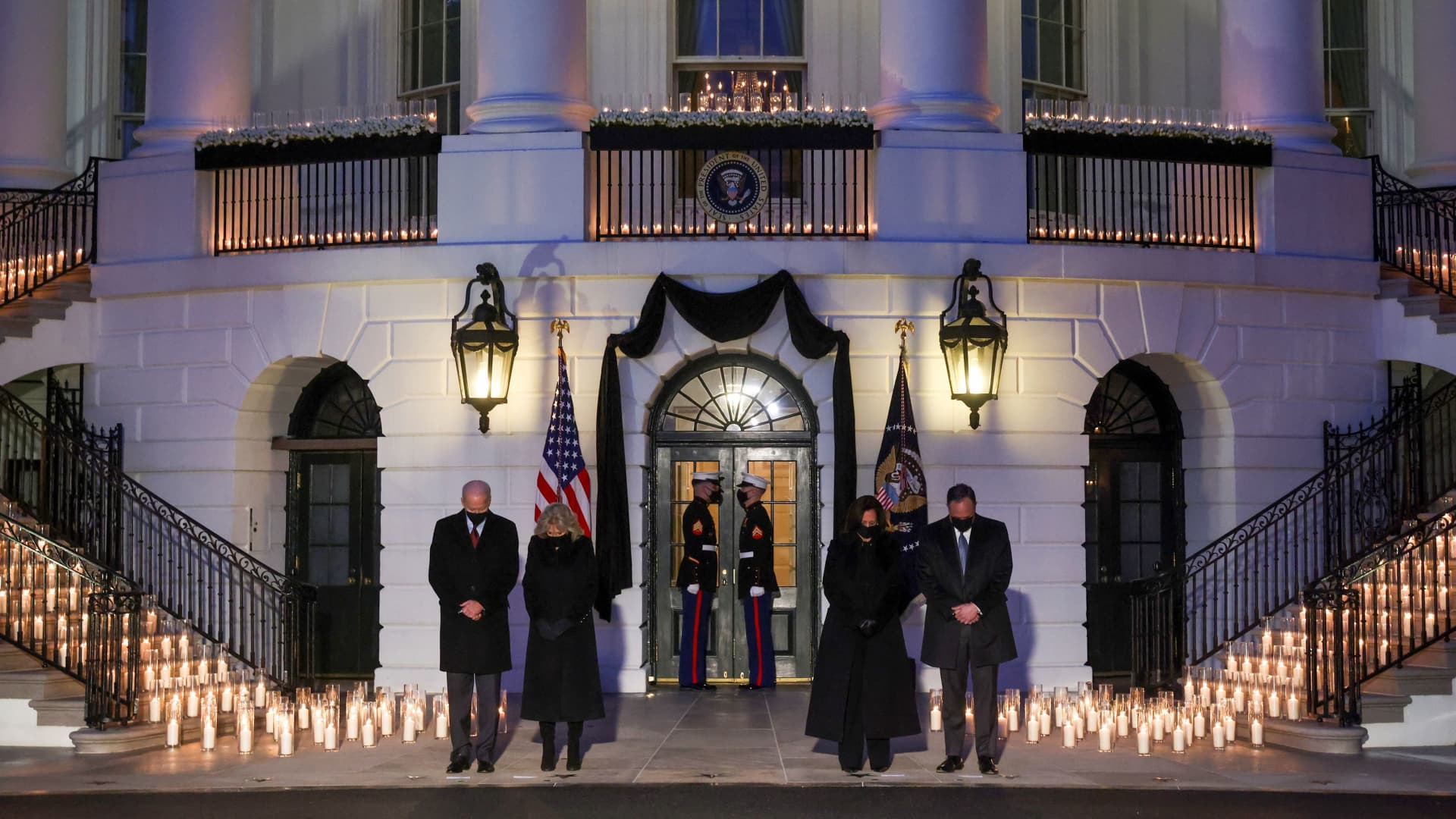 President Joe Biden, his wife Jill Biden, U.S. Vice President Kamala Harris and Second Gentleman Doug Emhoff attend a moment of silence and candle lighting ceremony to commemorate the grim milestone of 500,000 U.S. deaths from the coronavirus disease (COVID-19) at the White House in Washington, U.S., February 22, 2021.