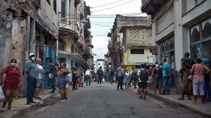 People queue to buy food in Havana, on February 2, 2021, as Covid-19 cases surge in the island nation.