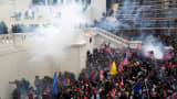 Police release tear gas into a crowd of pro-Trump protesters during clashes at a rally to contest the certification of the 2020 U.S. presidential election results by the U.S. Congress, at the U.S. Capitol Building in Washington, January 6, 2021.