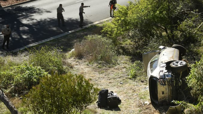 L.A. County Sheriff's officers investigate an accident involving golfer Tiger Woods along Hawthorne Blvd. in Rancho Palos Verdes, February 23, 2021.
