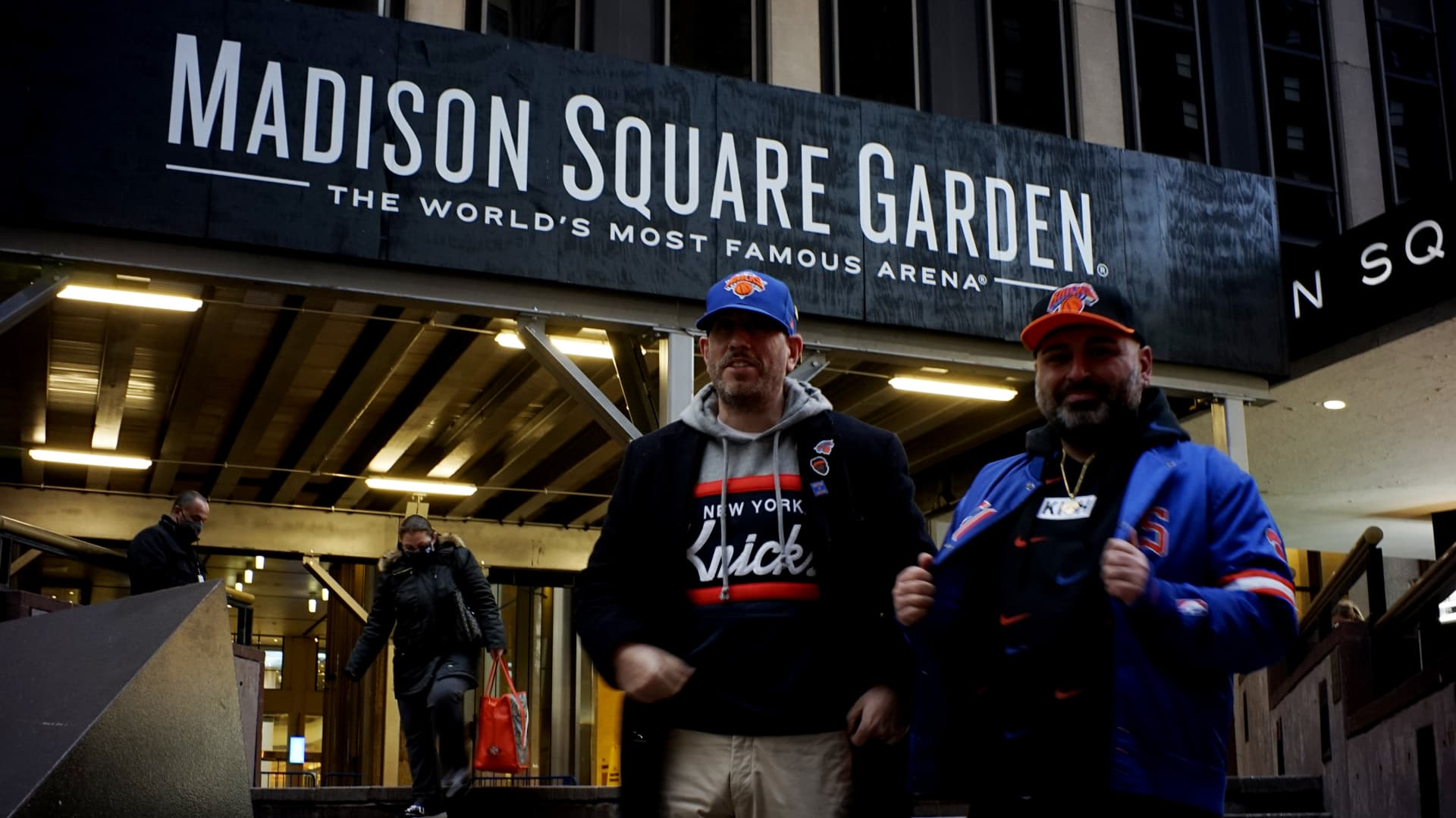 Fans arrive to Madison Square Garden before the game between the Golden State Warriors and New York Knicks on February 23, 2021 in New York City. For the first time since the onset of the COVID-19 pandemic, Madison Square Garden reopened its doors at limited capacity.
