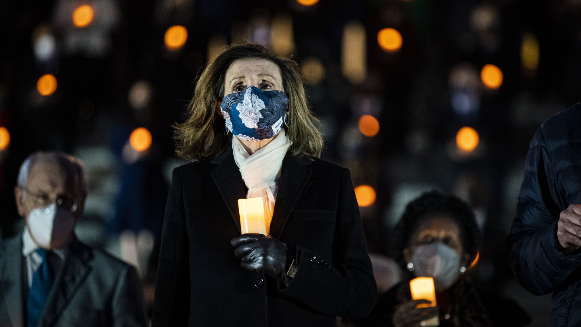 Speaker of the House Nancy Pelosi (D-CA), joins fellow members of Congress to observe a moment of silence on the steps of the U.S. Capitol, on February 23, 2021 in Washington, DC.