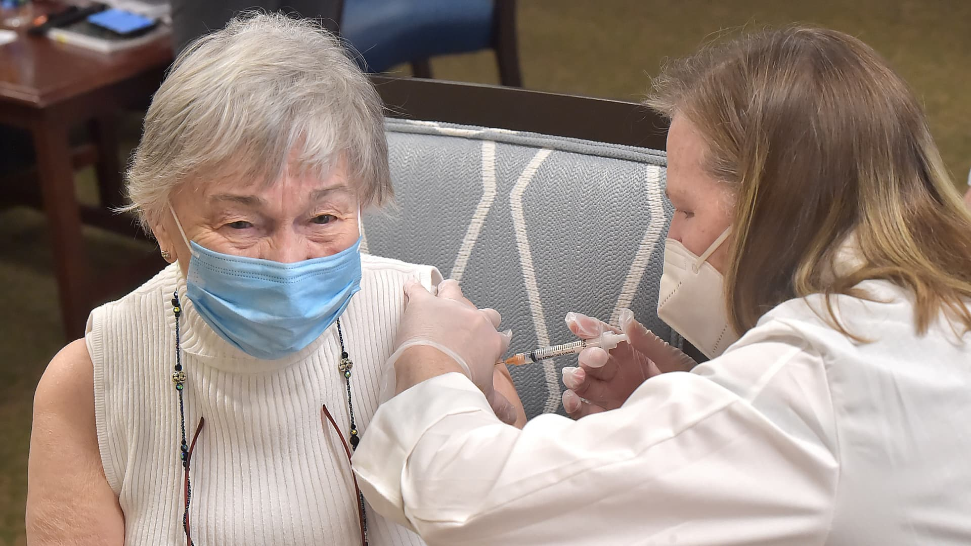 Barbara Comer, 90, gets her second shoot of the Pfizer BioNTech COVID-19 vaccine from CVS Pharmacist Sheila Esgro during a clinic at The Watermark at Bellingham in East Goshen Wednesday.