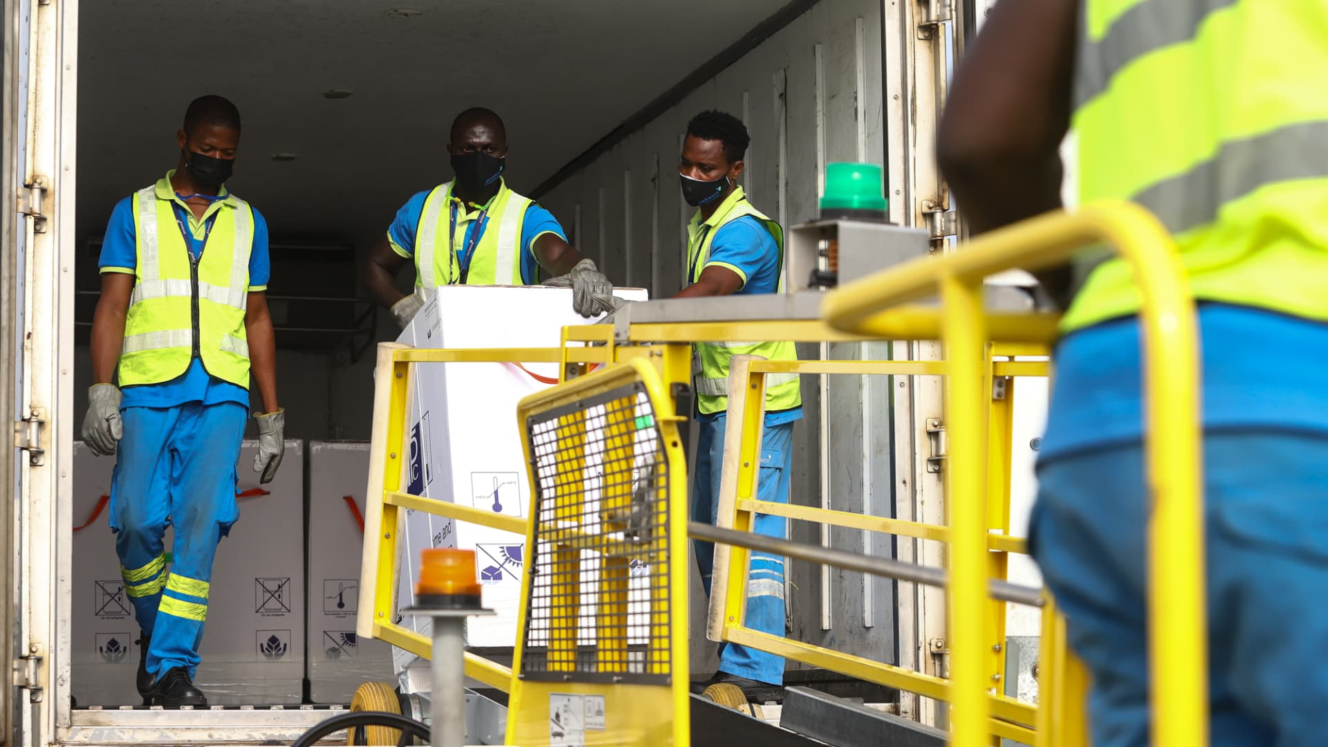 Airport workers unload a shipment of Covid-19 vaccines from the Covax global Covid-19 vaccination programme, at the Kotoka International Airport in Accra, on February 24, 2021.