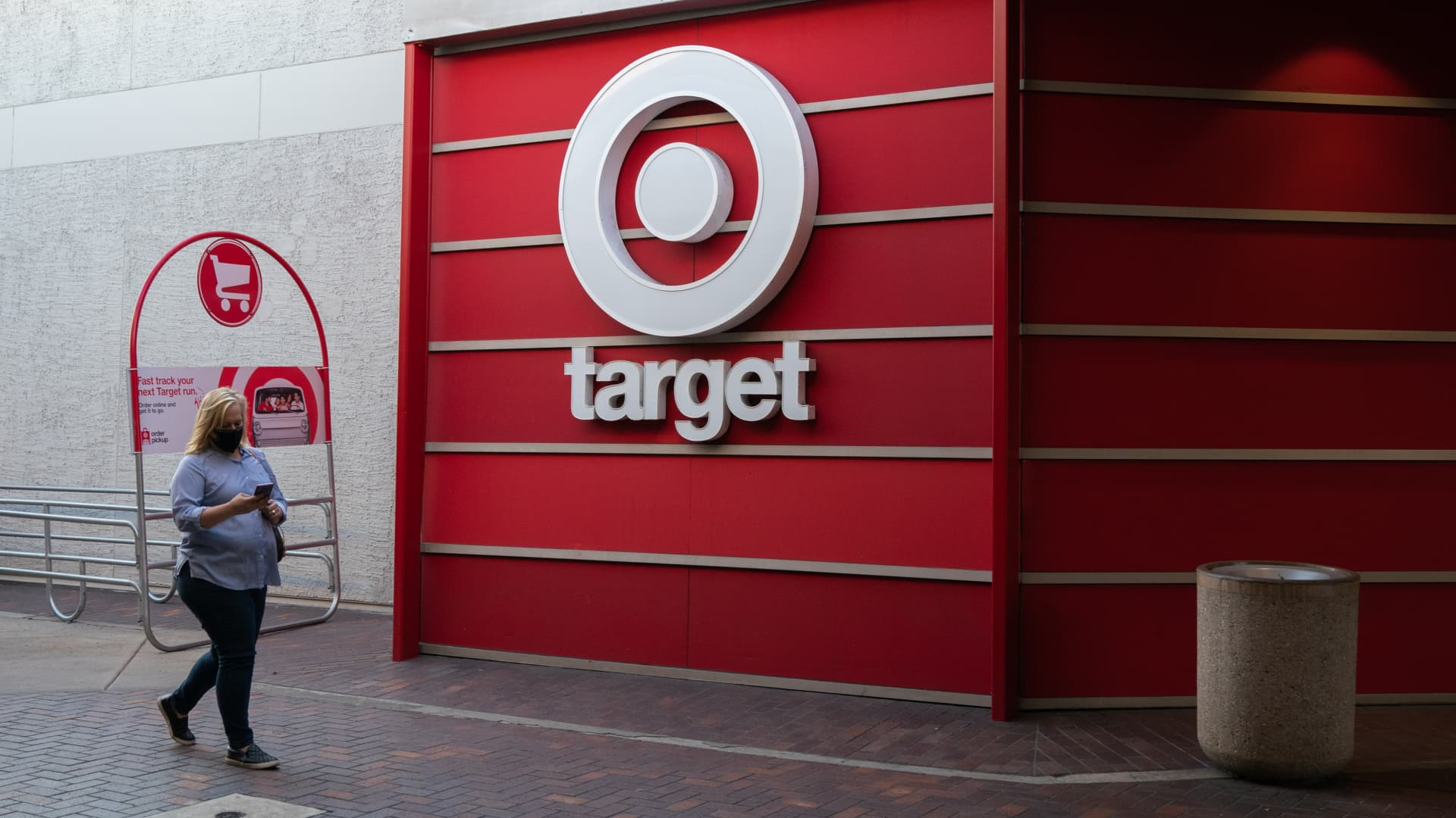 A person wearing a protective mask walks past a Target Corp. store at the Grossmont Center Mall in La Mesa, California, U.S., on Thursday, Feb. 11, 2021.