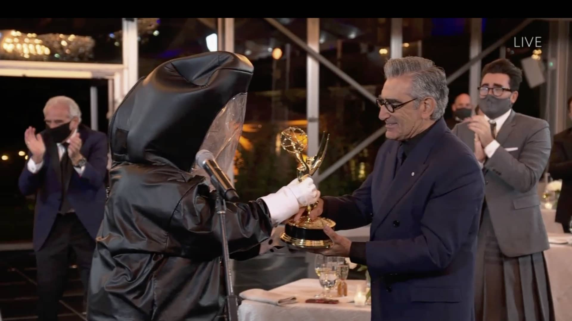 Eugene Levy receives his Emmy Award for lead actor in a comedy series during the September 20, 2020 ceremony.