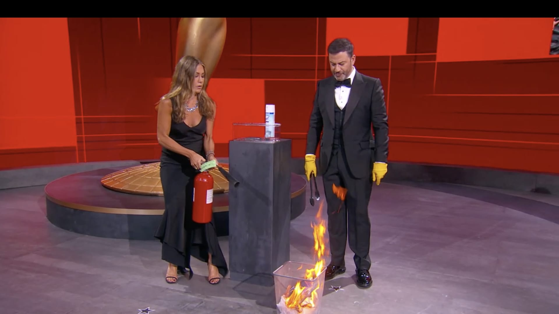 Host Jimmy Kimmel (right) and presenter Jennifer Aniston (right) work to put out a fire on the set of the 72nd Emmy Awards will broadcast SUNDAY, SEPT. 20 (8:00 p.m. EDT/6:00 p.m. MDT/5:00 p.m. PDT), on ABC. (ABC via Getty Images) JENNIFER ANISTON, JIMMY KIMMEL