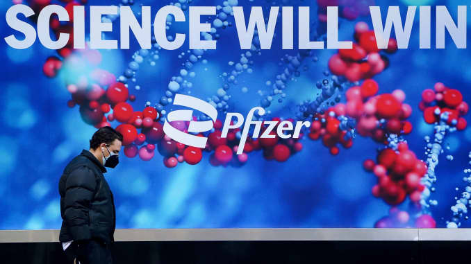 A person walks past the Pfizer building in New York City, March 2, 2021.
